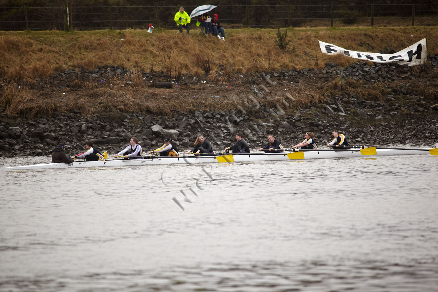 A womens coxed eight finishing