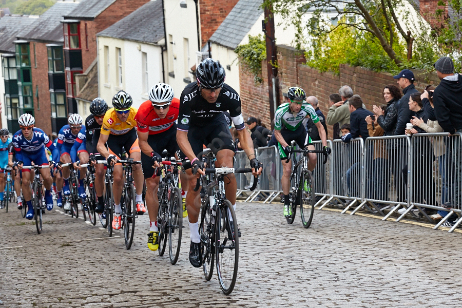 Kristian House leads the peleton up South Street in Durham