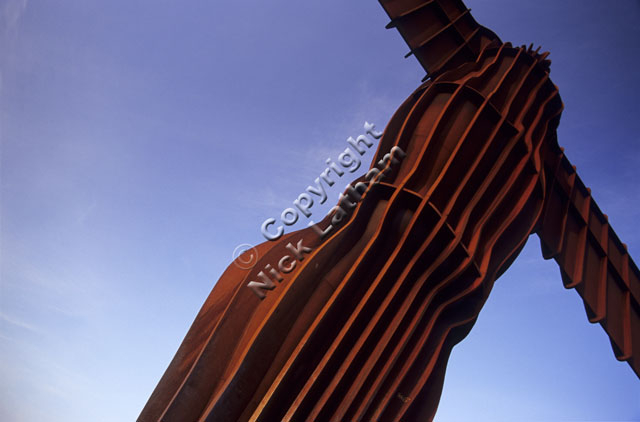 sculpture Tyne and Wear Gateshead Antony Gormley steel rust brown blue sky tall public art landmark famous