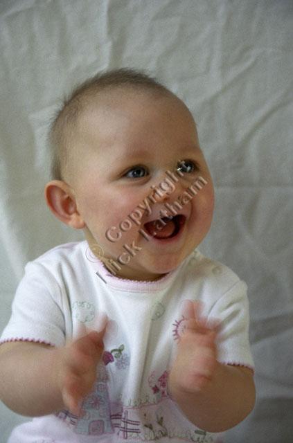 child baby portrait clap smile girl