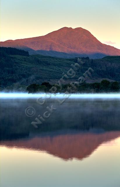 Scotland Trossachs loch water mist reflection lake still calm tranquil outdoor landscape munro mountain hill