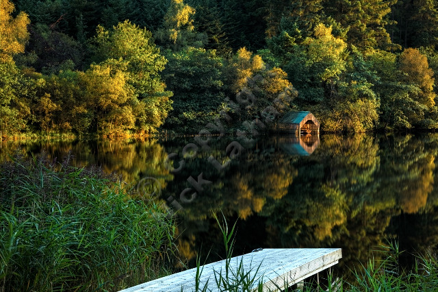 Scotland Trossachs loch lake water reflection jetty landing reed tree wood calm tranquil peaceful HDR