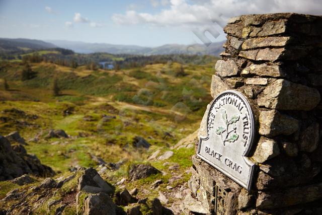 pillar cairn sign rock fell Wainwright Lake District UK England explore outdoors adventure walk hike climb hill mountain sun