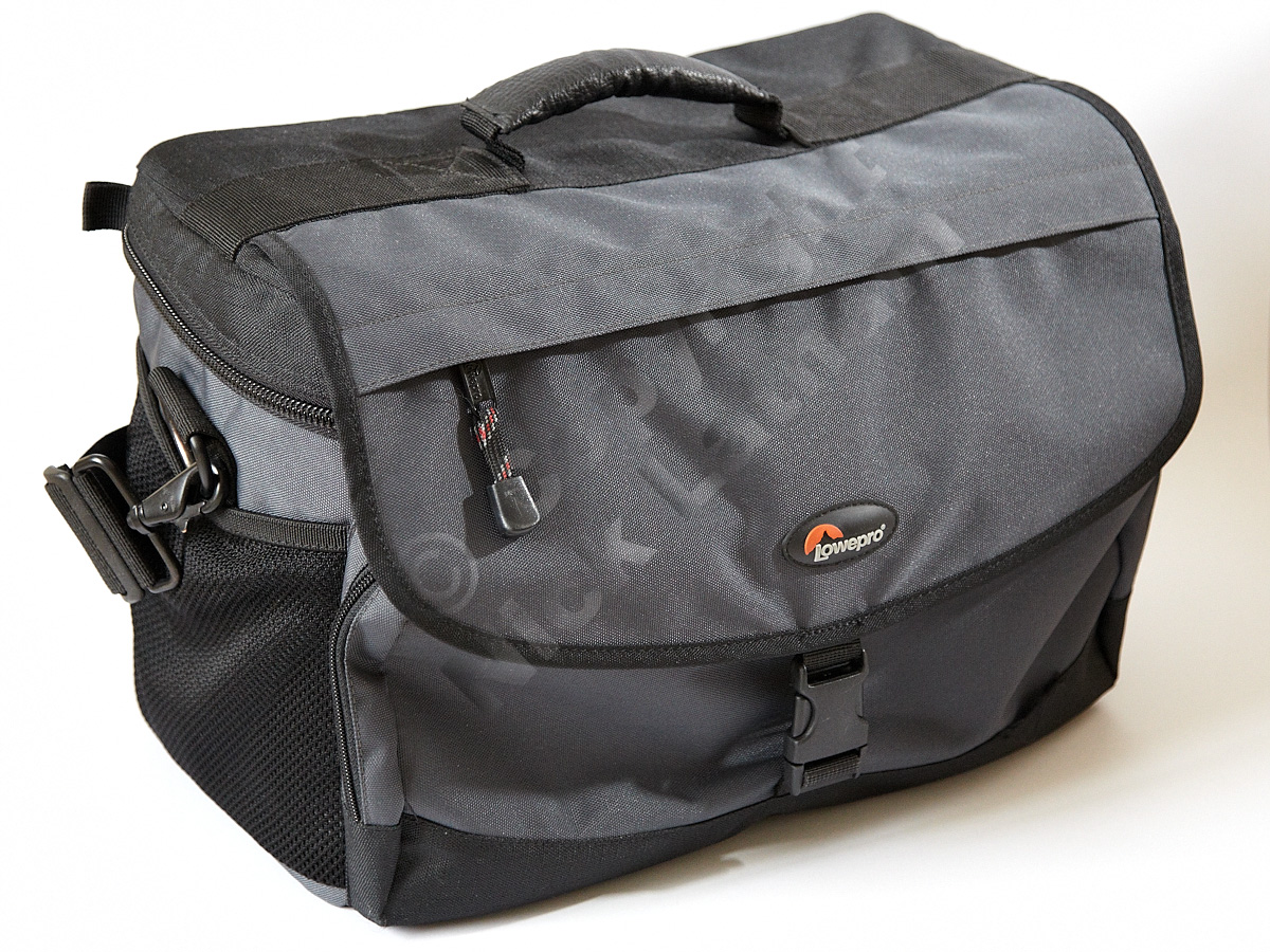 Reporter-style top-opening camera bag