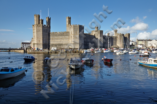 Gwynedd river tourist attraction Wales King Edward I defence rule conquest turret distinctive Prince battlements harbour boats blue